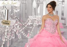 Style FZXOA Rhinestone and Crystal Beading on a Ruched Tulle Ball Gown  This Dreamy Tulle Quinceañera Ballgown Features a Gorgeous Gemstone Beaded Bodice with Corset Back. The Pick-up Skirt is Accented with Delicate Scattered Beading. Matching Bolero Jacket included. Colors Available: Champagne, Ballet Pink, Bahama Blue, White.