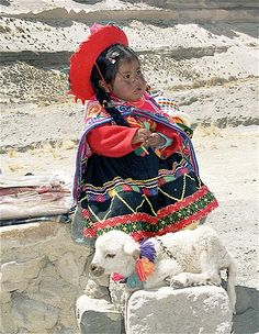 Peru |  A young girl photographed in Arequipa - Chivay wearing her traditional beautifully embroidered clothes |  © Rita Willaert