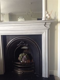 Fireplace makeover in Annie Sloan Chalk Paint (undercoat and mantle French Linen, top coat Old White)