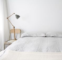 all white. this is basically my bedroom. except even the bedside chair is white.