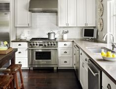 White Kitchen Cabinets, white backspash, great concrete counters, dark wood floors