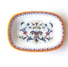"""RECTANGULAR SERVING BOWL: DERUTA: 10"""" (25cm) Long x 7"""" (18cm) Wide.    This 16th century pattern is made up of scrolled floral elements from the borders of Renaissance plates divided into sections. The design comes from frescoes by Perugino at the Collegio del Cambio in Perugia. This pattern is important because we see the first use of yellow, orange, and blue. Previously only green and brown were used.    This Piece is hand painted in #Deruta.  #Gubbio #Tuscany #Italy #Ceramics"""