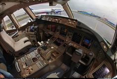Wide view of the cockpit of a ТРАНСАЭРО Boeing 777as seen from the F/O seat while parked at Domodedovo Int'l Airport.