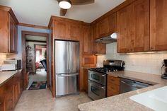 kitchen cabinet color is great, high range hood. cabinet door style