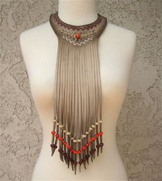 This stunning fringe choker comes in many colors of suede and beads.