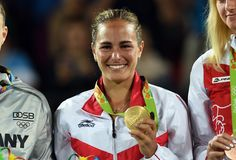 Monica Puig with her gold medal PUR