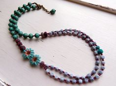Daisy, daisy  ~ handmade long daisy necklace in turquoise, powder blue and burgundy with artisan polymer, glass and vintage acrylic   Daisy, daisy, give me your answer true....turquoise and copper artisan polymer daisies are the focal to this pretty, long double-strand necklace with powder blue and maroon long strands. Who would have thought this colour scheme would work but it really does! Long and elegant, this necklace is perfect for layering and wearing over high-necked tops, but is also…