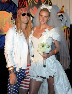 """Levine AnneV Maroon HalloweenP Arty -- One of the evening's hosts, Maroon 5 frontman Adam Levine, was barely recognizable in his Axl Rose costume. And in a nod to Guns N' Roses' """"November Rain"""" video, Adam's girlfriend, model Anne V, posed as the bride that Axl's ex, Stephanie Seymour, played in the clip. (10/31/11)"""