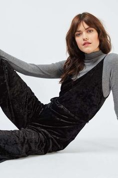 Opt for a chic all-in-one look with this luxe wide-leg velvet jumpsuit. In a sleek black, it comes with a v-neckline, metal zip and tie-waist to cinch in the waist. #Topshop