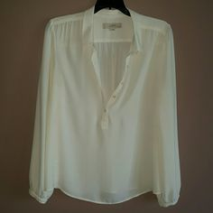 Off white long sleeved LOFT blouse Lightweight, off white/cream colored long sleeved LOFT blouse. 5 buttons along the chest. Button closures at the wrists also. Size is Medium Petite. LOFT Tops Blouses