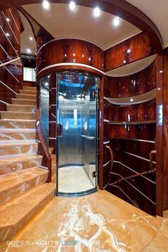 Luxury yacht stairs and circle elevator