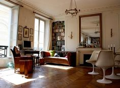 Parisian apartment is tres chic.  Not into the tulip chairs so much, but everything else is lovely.