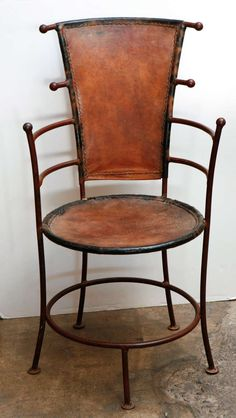 Pair of circa 1940 French Iron and Leather Chairs   From a unique collection of antique and modern chairs at https://www.1stdibs.com/furniture/seating/chairs/