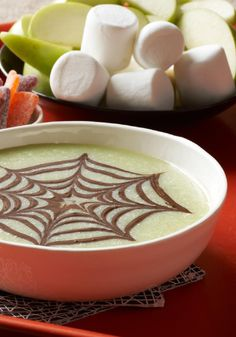 White chocolate fondue with a creepy design and a dose of food coloring makes a dipping dessert that's spooky enough for Halloween!