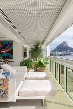 The project of this apartment originally with four suites privileged the integration of the spaces transforming into only two suites the existing area: the first to a master suite with generous proportions and the second to receive guests with smaller area.  The balcony also was integrated to living room valuing the views for the Rodrigo de Freitas Lagoon the Dois Irmãos Hill and the Corcovado. Also provided the expansion of social area dining and living room.  The chosen furniture presents…