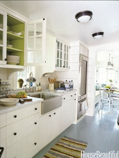 Love the pop of green inside the cabinets
