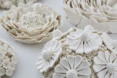 British artist Vanessa Hogg creates vases and decorative wall art objects from hundreds of miniature porcelain flowers. Daisies, chrysanthemums, dahlias, hydrangeas give her endless inspiration. Vanessa was born and raised in Africa surrounded by exotic nature and bizarre plants. Her mother and grandmother were keen gardeners, so Vanessa loved the magical world of flowers.