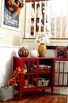 Fall decor in entryway with Target Threshold bookcase and chalkboard art.