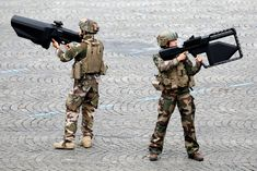 """""""French soldiers carrying anti-drone weapons during the military parade on the Champs-Elysees. In the French manual they're called, """"Fusil de fréquence bastille"""" The English translation would be """"Bastille Frequency Gun"""" ."""