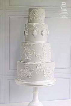 Dove grey wedding cake by Sophia's Cake Boutique - http://cakesdecor.com/cakes/208420-dove-grey-wedding-cake