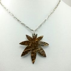 Medicinal Healing Leaf Pendant Necklace This necklace has an alpaca silver chain and Medicinal Healing  Leaf Pendant made from coconut shell. Jewelry Necklaces