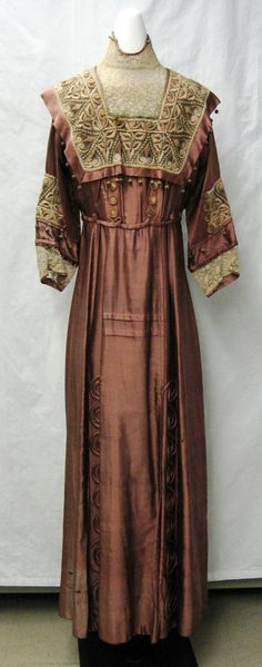 chemung-valley-curator:  Mauve silk dress with heavily embroidered trim, 1912, from the collection of the Chemung Valley History Museum