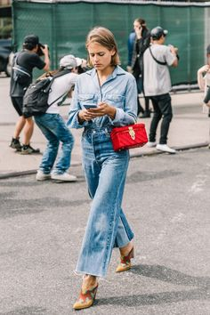 Denim on denim with great boots and pop of red. Cala and ades Phibi would be great.