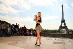 Maria Sharapova Photos: 2014 French Open - Day Fifteen. Maria Sharapova of Russia poses in front of the Eiffel Tower with the Coupe Suzanne Lenglen at Trocadero, following her victory in the women's singles final match against Simona Halep of Romania, on day fifteen of the French Open on June 8, 2014 in Paris, France.