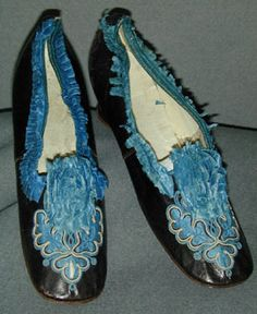 """Black glacé kid leather shoes with blue silk trim and blue cotton tambour embroidery, probably French, c. 1850's. Label: [stamp] """"Jolly 310. Massez & Co."""""""