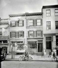 This photo features TWO Jewish-owned businesses! There's a Shannon & Luchs sign on the deli/grocery and, at far right, is the Dime Messenger Service. Shannon & Luchs is still around today and you can read about the Dime Messenger Service here: http://www.jhsgw.org/exhibitions/online/jewishwashington/exhibit-images/dime-messenger-service-photo