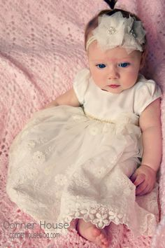 Cute baby blessing dress, adorable little girl. Love her eyes. I like this idea of a shorter dress, it would be useable on a regular Sunday as well as blessing day. The long ones are gorgeous though... (;