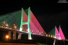This is what the Vasco da Gama Bridge looked like during the Euro2004 in Portugal. Pretty cool, with the colours of the Portuguese flag - Lisbon, Portugal
