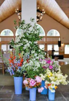 Primroses, lilacs, tulips, delphiniums, godetias, roses, and Queen Anne's lace