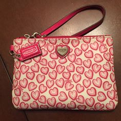 Heart Coach Wristlet - brand new Cute for any occasion, has two card slots and is in maculate condition! Taking reasonable offers!! Coach Bags Clutches & Wristlets