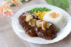 Burger Steak (that's what we call it in Philippines) is made out of minced meat shaped to mimic steak drenched in a brown gravy commonly topped with mushroom