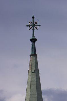 the church tower, cross, lightning rod