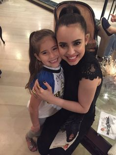 Sofia Carson, and a fan. I love it when I see pictures of her, and her fans! -Justin