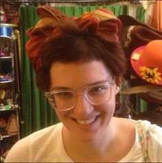 Stephanie looks so cute in her vintage silk scarf she snagged off our $10 table and tied on her head!
