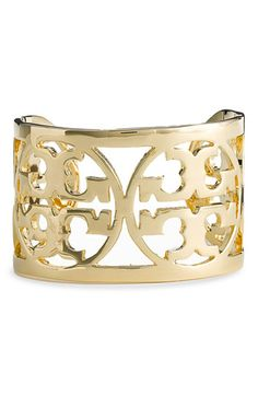 Tory Burch cuff bracelet... (To go with my Alexander McQueen clutch) 😉
