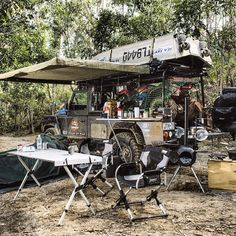 Land Rover camping on the river.
