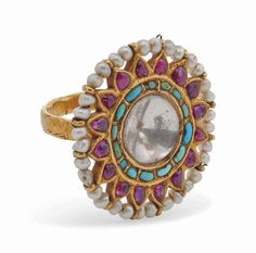 A large turquoise, ruby and pearl gold ring India, late 19th/early 20th century