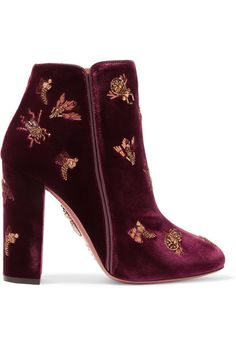 For Fall '16, Aquazzura founder Edgardo Osorio references the ornate palatial floors, decadent jewelry and abundance of textures in Russia - he was particularly inspired by a trip to Saint Petersburg. Crafted from plush claret velvet with sleek leather trims, these block-heeled 'Fauna' boots are lavishly decorated with insect-style embroidery in gold threads and beads.