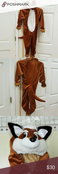 Fox 1 pc kids costume Fantastic fox costume with attached with tail and hood. Never worn. One still in bag. Wicked Costumes Halloween