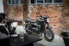 Relaxing and admiring the cool retro lines of the new Triumph Bonneville T120 Black.