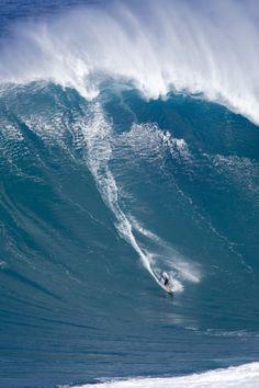 Hawaii, Maui, Jorge Martinez surfs huge wave at Jaws aka Peahi.