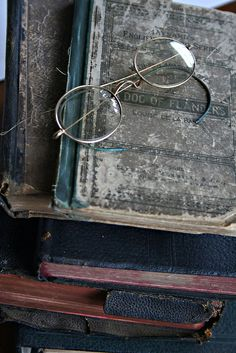 Idea for my bedroom.  I have some old glasses that belonged to loved ones who have passed away.  I think mixing them in with old books would look nice in my bedroom.