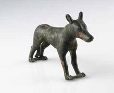"""Egypto-Roman Bronze Sculpture of a Male Dog - PF.5491 Origin: Egypt Circa: 300 BC to 100 BC  Dimensions: 3"""" (7.6cm) high x 5"""" (12.7cm) wide  Collection: Egyptian Antiquities Style: Ptolemaic Medium: Bronze"""