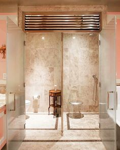 This Upper East Side home is the perfect combination of fancy and fun decor. The bathroom is stunning with double showers and pale pink walls.