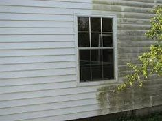 Before and after of a house wash. Spruce up your home exterior.