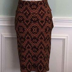 LuLaRoe Cassie skirt size XSSALE SALE NWT LuLaRoe Cassie skirt size XS. Brown with orange geometric pattern. LuLaRoe Skirts Pencil